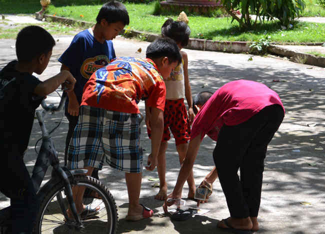 Local Kids Playing Petanque in Laos, French Influences Southeast Asia